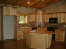 Kitchen ceiling in a log home by Dillwood LLC