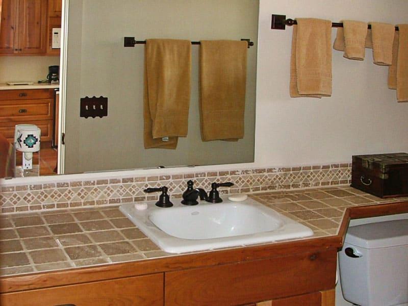 bathroom counter with custom tile