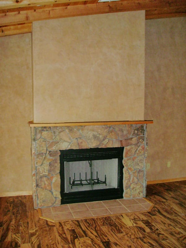 gas fireplace with rock work and Venetian plaster