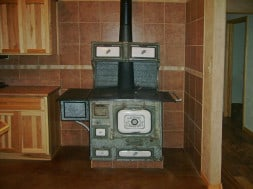 wood-burning stove with tile surround
